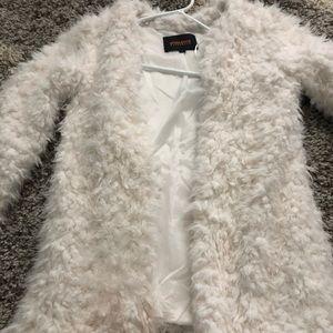 White fur coat/jacket.